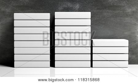 Row of book stacks with blank hardcover, with chalkboard background.