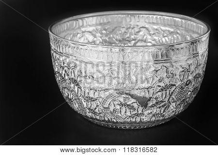Antique silver Thai bowl on black background