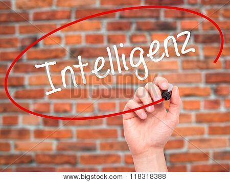 Man Hand Writing Intelligenz (intelligence In German) With Black Marker On Visual Screen