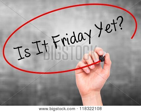 Man Hand Writing Is It Friday Yet? With Black Marker On Visual Screen