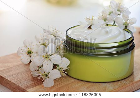 Jar of herbal body cream