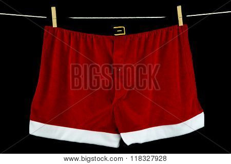 Christmas Underwear On Washing Line On Black Background