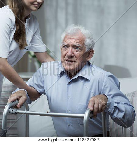 Man Using A Walking Frame