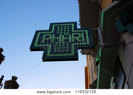 Neon Green Cross Sign
