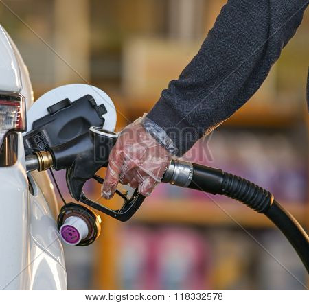 fuel nozzle in pouring to car, close-up.