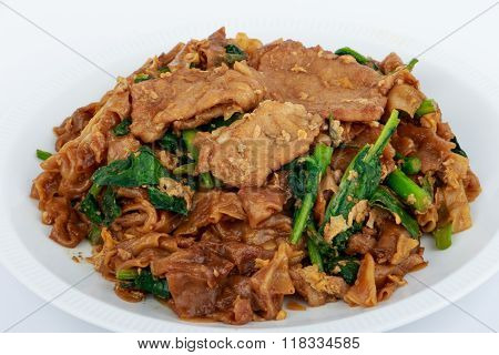 Stir fried flat noodle and pork with dark soy sauce