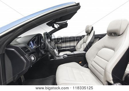 Car interior luxury cabriolet with white seats