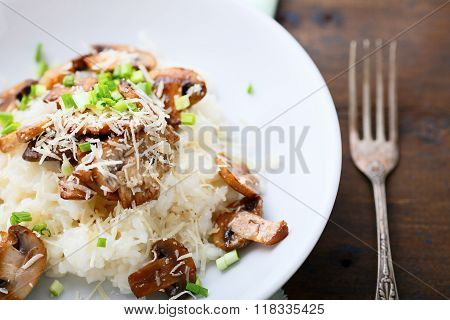 Risotto With Mushrooms On White Plate