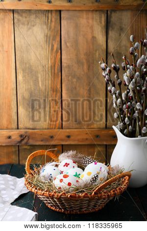 Colored Easter Eggs And Young Willow Branches