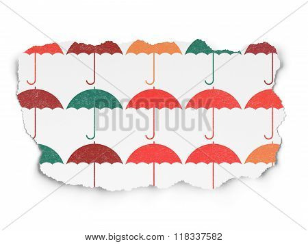 Protection concept: Umbrella icons on Torn Paper background