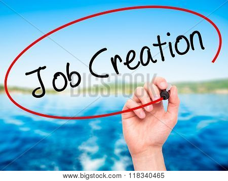 Man Hand Writing Job Creation With Black Marker On Visual Screen