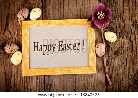 Happy Easter Vintage Easter decoration on old wooden board