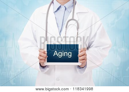 Doctor holding a tablet pc with aging sign on blue background