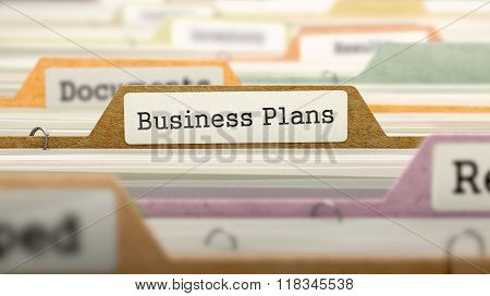 Business Plans Concept on Folder Register.
