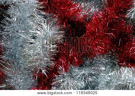 Christmas tinsel silver and red black background
