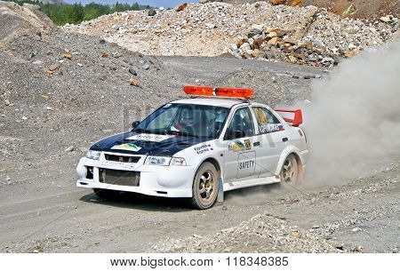BAKAL, RUSSIA - AUGUST 13: Safety car Mitsubishi Lancer Evolution V takes part at the annual Rally Southern Ural on August 13, 2010 in Bakal, Satka district, Chelyabinsk region, Russia.