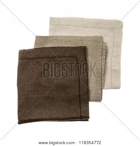 Linen cloth napkins in brown and beige natural colors isolated on white background