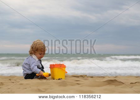Boy With Toy Trowel Bucket