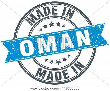 made in Oman blue round vintage stamp