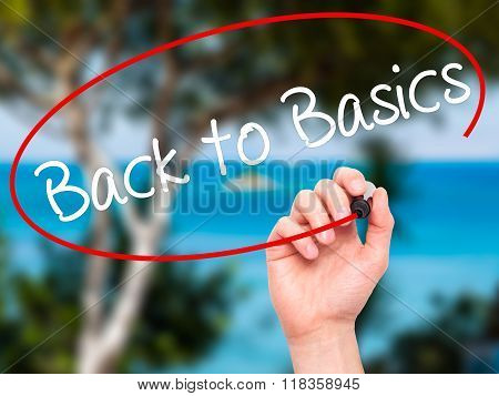 Man Hand Writing Back To Basics With Black Marker On Visual Screen