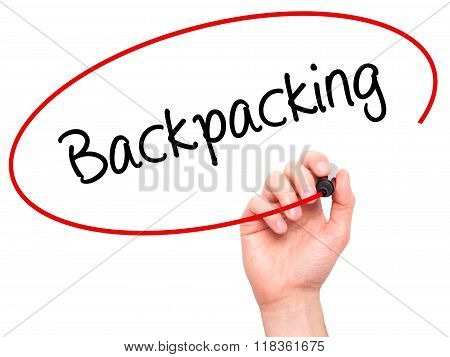 Man Hand Writing Backpacking  With Black Marker On Visual Screen