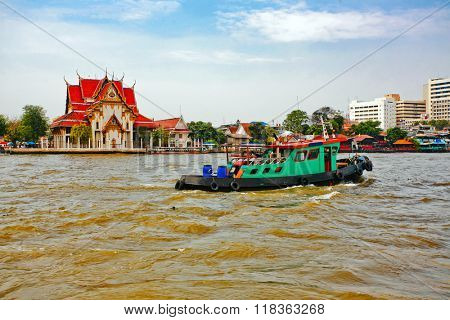 Motor boat transporting across the river Chaopraya in Bangkok