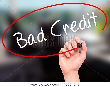 Man Hand Writing Bad Credit With Black Marker On Visual Screen