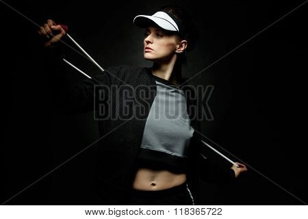 Woman Athlete Workout With Resistance Band On Black Background