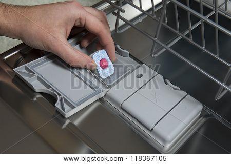 Putting Tablet In Dishwasher Machine