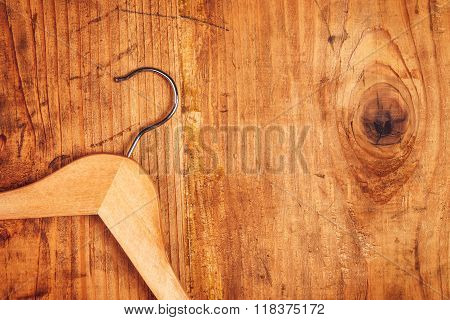 Retro Cloth Hanger On Rustic Wooden Background, Top View