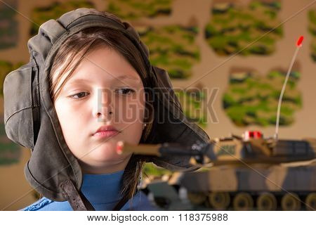 Girl Playing Toy Military Tank