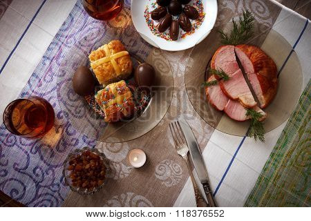 Traditional Easter Dinner Set With Sliced Meat With Herbs, Chocolate Eggs, Easter Cake