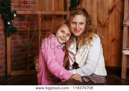 Portrait Of Happy Smiling Little Girl With Mother