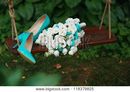 Wedding Bouquet Of White Roses And Blue Ribbons And Blue Patent Leather High-heeled Shoes