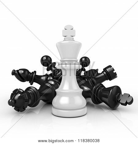 White king standing over fallen black chess pieces
