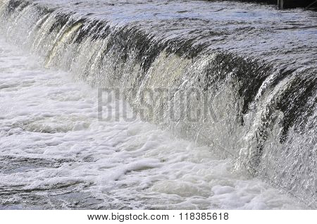 Waterfall on the river. Groyne hydraulic structure of on the river Ros. City of Bila Tserkva. Ukrain