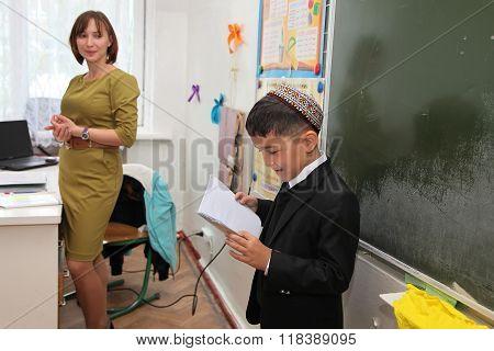 Ashgabad, Turkmenistan - November 4, 2014. Schoolboy Telling Lesson At The Blackboard. November 4, 2