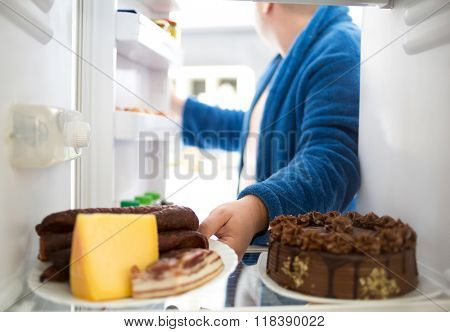 Overweight  guy take hard food like sausage and cheese instead healthy easy food