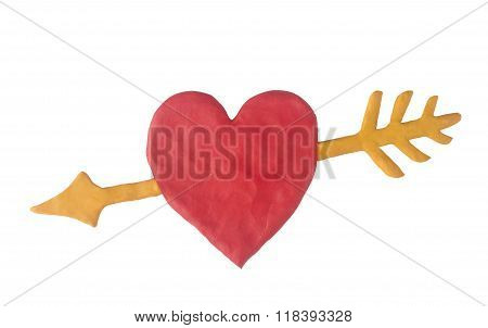 Red clay heart with a yellow clay arrow