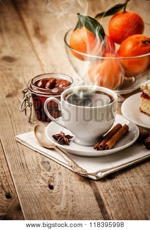 Hot coffee in cup breakfast and cake rustic style on wooden board