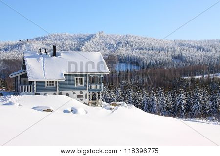 Log House In The Snow In The Sunhine