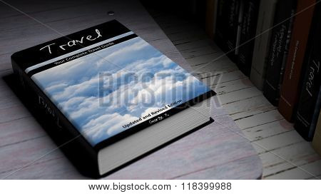Hardcover book Travel with illustration on cover, on wooden surface.
