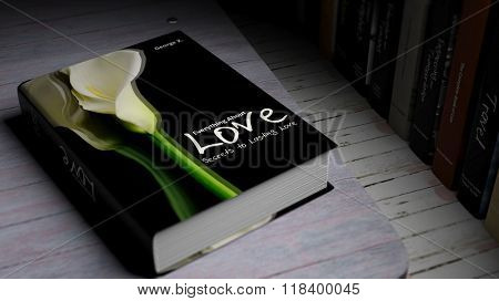 Hardcover book on Love with illustration on cover, on wooden surface.