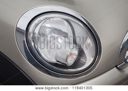 Close Up Of A Grey Car Headlight