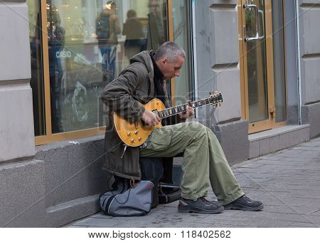 Lviv, Ukraine - October 18, 2015: Street Musician Playing An Electric Guitar Near A Store Window