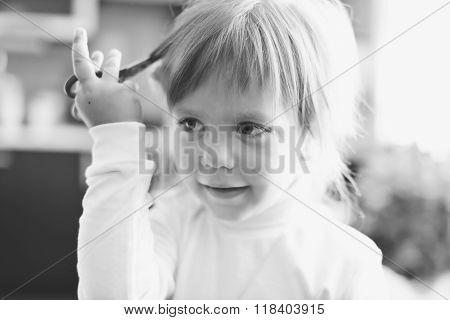 Cute Little Girl With Scissors