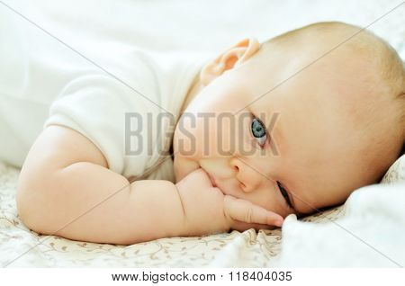 Baby With Finger In Mouth