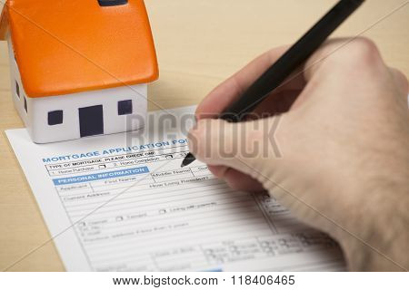 First time buyer filling in mortgage application form
