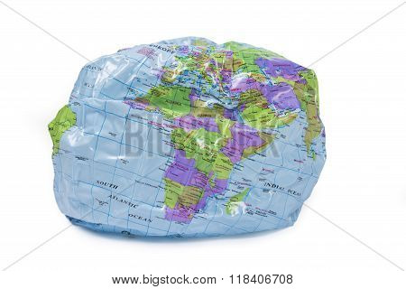 deflating world globe - global warming concept