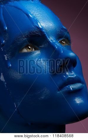 Portrait Of A Man Poured Blue Paint On A Pink Background